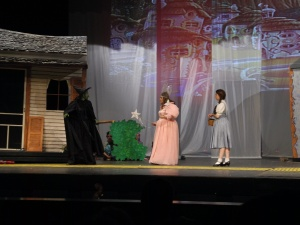 Erin, left, returns to Munchkinland, as the Wicked Witch.