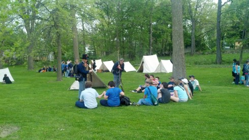 A group of students talk to the re-enactors Thursday evening.